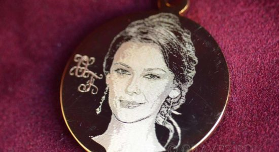 Photoengraving on a gold-plated pendant